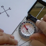 How to orient a map and take a bearing with a compass.