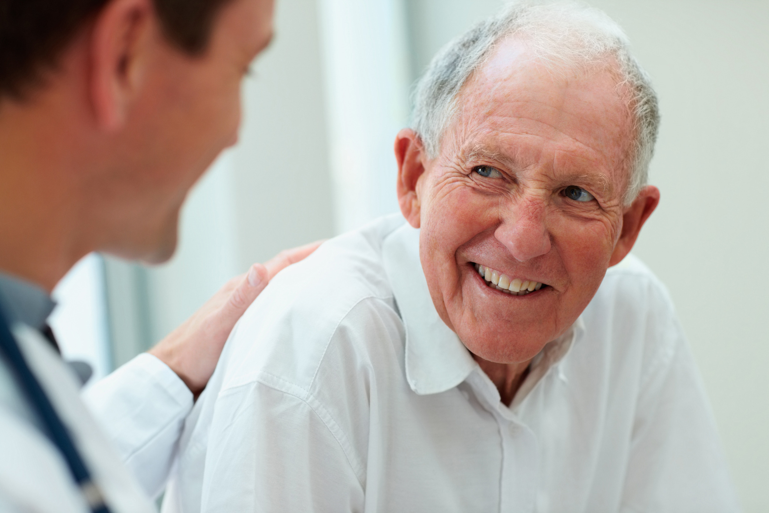 Happy senior citizen having a casual small talk with the friendly doctor