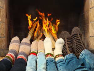 rp_A-family-with-their-feet-in-front-of-the-fireplace-300x226.jpg